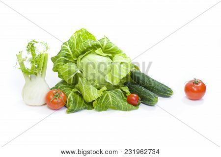 Green Cabbage. Red Tomatoes And Cucumbers On A White Background. Composition From Different Vegetabl
