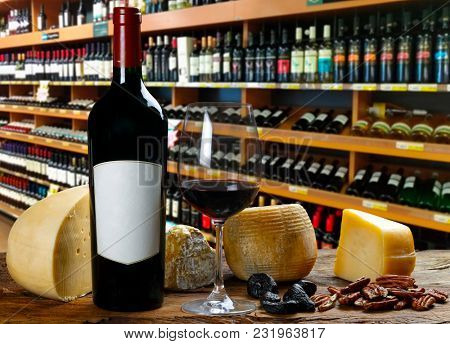 Red wine in the cellar with cheese