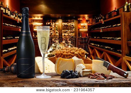 Champagne in the cellar with cheeses