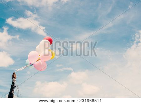 Happy Young Hipster Man Holding Colorful Balloons In Grassland Enjoy Life And Happy.