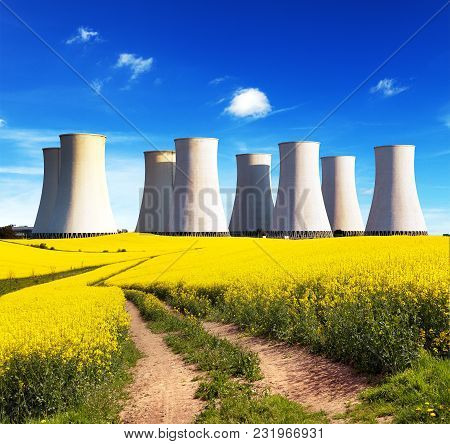 Panoramic View Of Nuclear Power Plant Jaslovske Bohunice With Golden Flowering Field Of Rapeseed, Ca