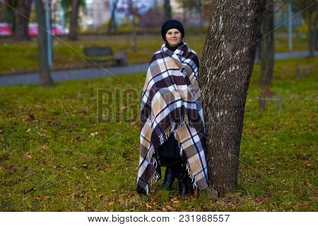 Attractive Middle Aged Woman Covered With Blanket Walk In Spring Park