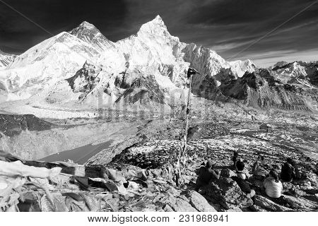 View Of Mount Everest, Lhotse And Nuptse With Prayer Flags And Tourists From Kala Patthar Black And
