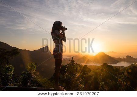 Girl Taking Pictures Of Sunrise In Vista Chinesa, Rio De Janeiro, Brazil