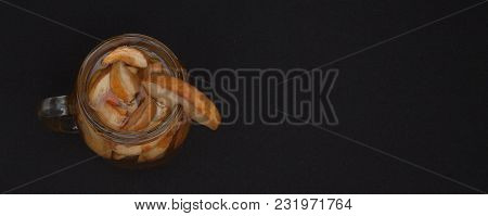 Compote Of Dried Fruits With Dried Fruit On A Black Background. Top View With Copyspace For Your Tex