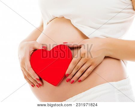 pregnant woman with red heart isolated on a white backgroung