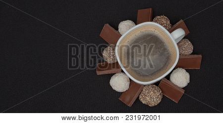 Cofe, Stack Of Black And White Chocolate Isolated On Black Background, Place For Text.