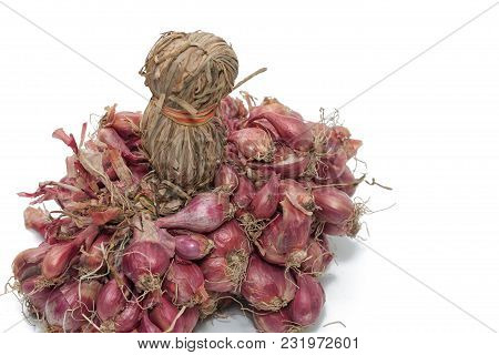 Bunch Of Dried Red Onions On White Background