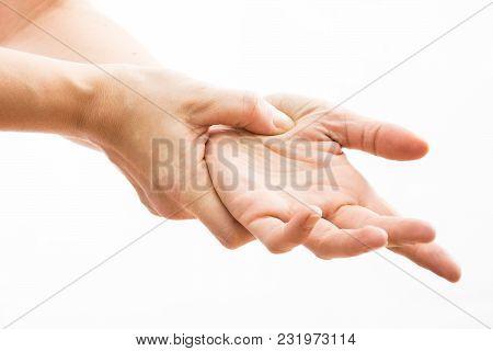 Female Hands Make Acupressure On The Arm,