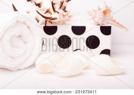 Set Of Skin Care With Silk Cocoon On A White Wood Background. Beauty Salon And Spa Concept. Contrast