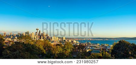 Panoramic View Of Seattle From Kerry Park With Mount Rainier Rising From Clouds Under A Three-quarte