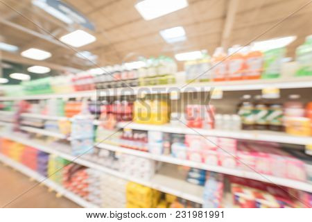 Blurred abstract soft drinks aisle in USA store. Fuzzy drink bottles display on supermarket shelves. The affordability, wide variety of sugary drinks contribute to the growing obesity problem in US poster