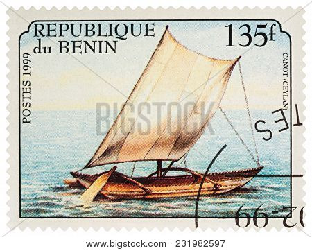 Moscow, Russia - March 20, 2018: A Stamp Printed In Benin Shows Old Traditional Sailboat, Outrigger