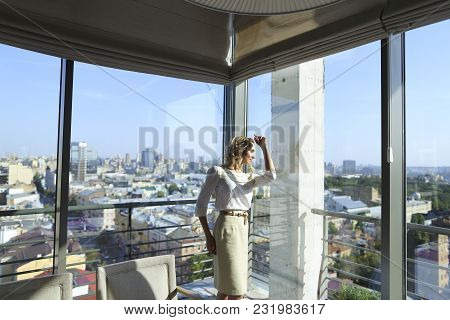 Female Person Standing At Restaurant Near Window With Buildings In Background. Concept Of Catering E