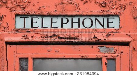 Old Red Telephone Booth Fragment. Close Up.