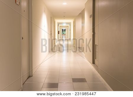 The Image Of Perspective Corridor In A Condominium. At Night.