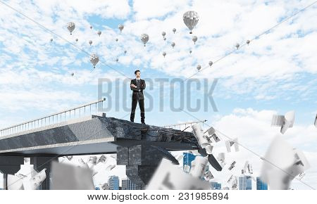 Confident Businessman In Suit Standing Among Flying Papers On Broken Bridge With Flying Balloons On