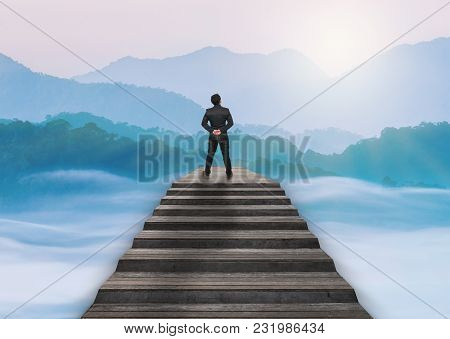 Businessman Climbed On Top Of The Stairs Over The Cityscape Which Can See Beautiful Scenary Of Mist