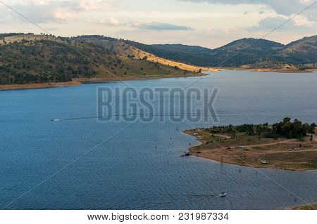 Aerial View Of Lake With Hills On Golden Hour. Nature Background