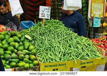 JERUSALEM, ISRAEL - DECEMBER 29, 2016: Bench with beans and avocados on the market of Mahane Yehuda in Jerusalem in Israel