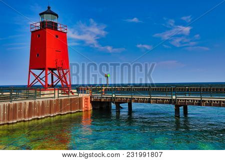 Charlevoix Michigan on Lake Michigan is a beautiful vacation destination.  The Charlevoix South Pier Light Station is a historical landmark and popular tourist attraction.