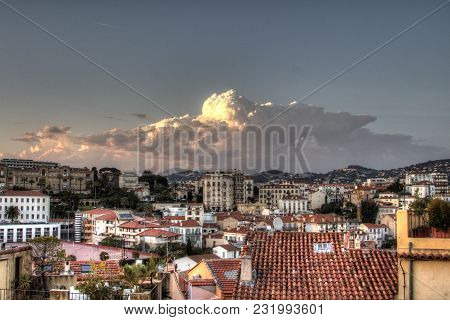 Pink Cloud Above The Hdr Italian City Roofs. Hdr Photo Of Small Italian City Roofs Under A Big Dark