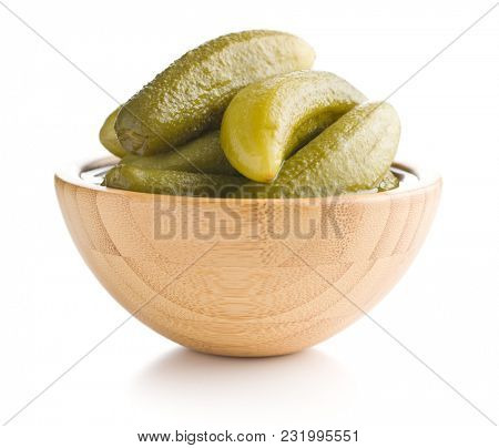 Preserved cucumbers isolated on white background. Tasty pickles.
