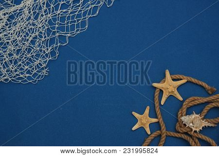 Starfish, Shell, Stones, Rope And Net Against A Blue Background. Summer Holliday. Nautical, Marrine