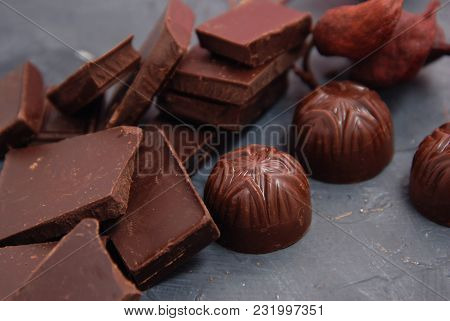 Chocolates Pieces Isolated On Gray Background. Chocolate. Fine Pieces Of Chocolates. Chocolate Sweet
