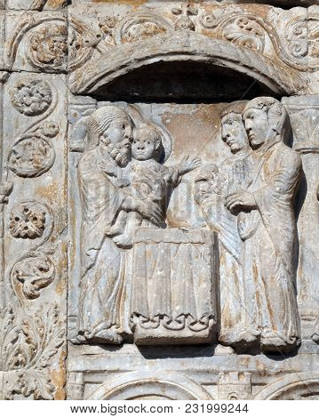 VERONA, ITALY - MAY 27: Presentation of Jesus in the Temple, medieval relief on the facade of Basilica of San Zeno in Verona, Italy, on May 27, 2017.