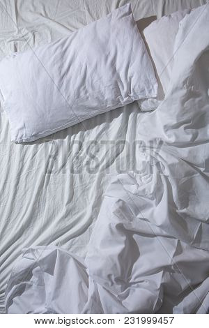 A Crumpled White Bed In The Morning Light