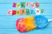 Broom for cleaning on colorful background. Multicolored fluffy duster for cleaning house and colorful letters spring cleaning. Spring cleaning still life. poster