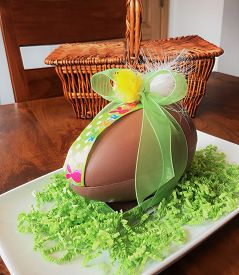 Chocolate Easter Egg. A Fancy Large Belgian Chocolate Easter Egg Filled With Chocolate Praline Eggs