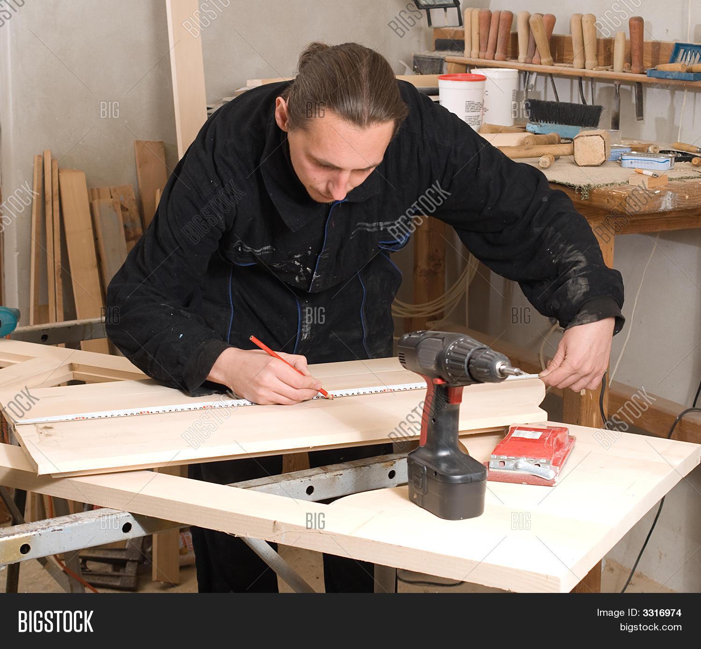 Carpenter Stock Photos and Images 87075 Carpenter