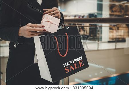 Close Up Of Female Hands Holding Beautiful Box And Shopping Bag With Printed Written Words Black Fri