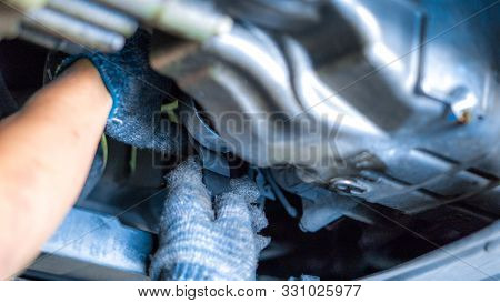 Engine Oil And Car Maintenance Service Concept - Close Up  Mechanical Hand With Engine Oil Filter Re