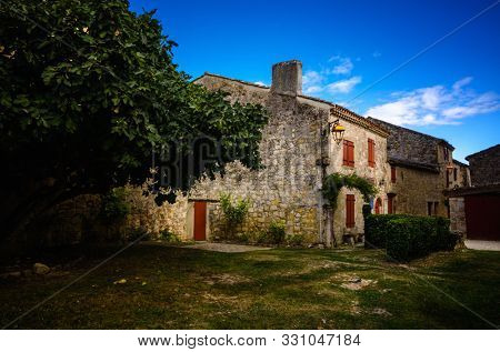 Larressingle, one of the most beautiful and small fortified villages in France with walls, towers, moats, entrance bridge, castle, fortified church and medieval houses attached to the walls