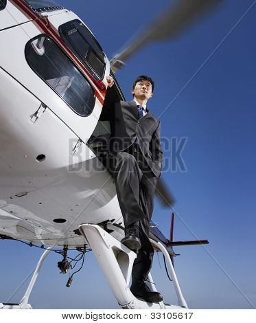 Asian businessman on helicopter