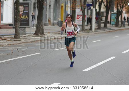 Dnipro, Ukraine - September 22, 2019: Male Winner (artem Kazban) Running On Dnipro City Street Durin