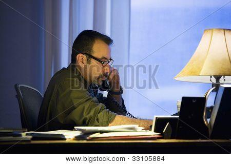 Hispanic businessman talking on telephone
