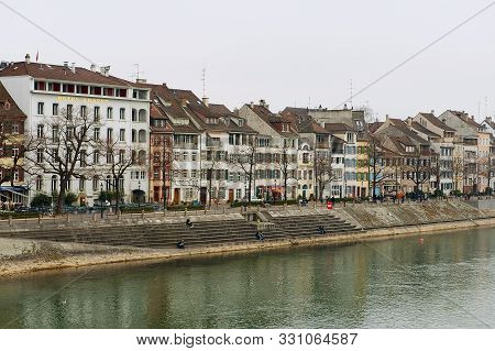 Basel, Switzerland - March 01, 2009: View To The Buildings At The Bank Of Rhine River In Basel, Swit