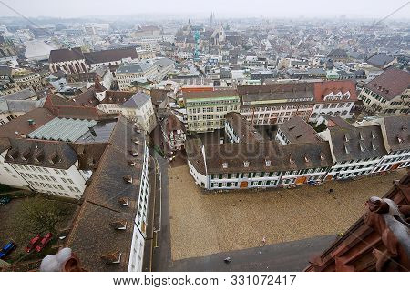 Basel, Switzerland - March 02, 2009: View To The Historical Buildings At The Munsterplatz Square Fro