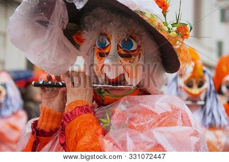 Basel, Switzerland - March 02, 2009: Women Plays  Flute During Parade At Carnival In Basel, Switzerl