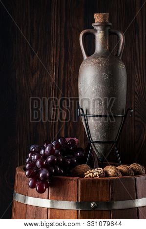 Old Red Wine In A Jug. Traditional Production And Storage Of Wine. Copy Space. Close Up And Vertical