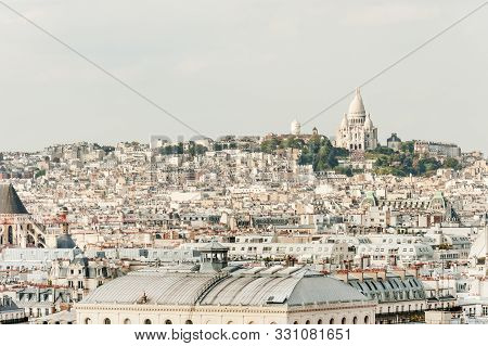 Typical Paris Architecture And Basilique Sacre-coeur On Montmartre Hill, The Highest Point Of Paris,
