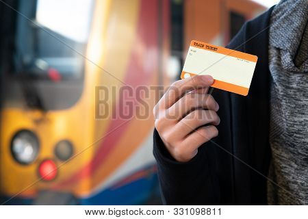 Hand Holding One Blank Train Ticket With Europe Train For Travel And Background Concept. Blank Ticke