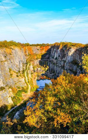 Limestone Quarry Velka Amerika In Bohemia, Czechia. Partly Flooded Quarry Surrounded By Rocks And Tr
