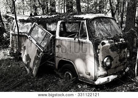 White, Ga / Usa - October27, 2018 - Image Of An Old Scrap Van In The Woods At A Junk Yard.