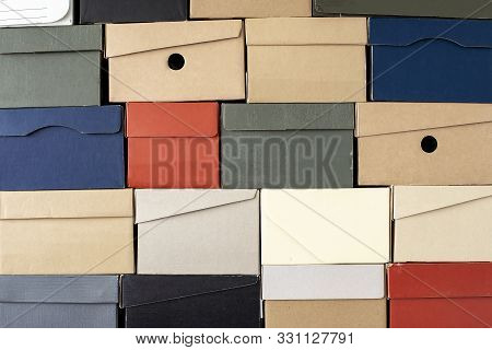 Pile Of Evenly Folded Shoe Boxes, Can Be Used As A Background Or Wallpaper. Seasonal Sales And Disco