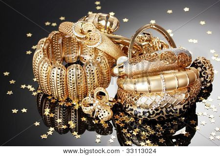 Beautiful golden jewelry on grey background